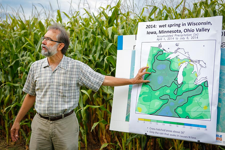 Peter Scharf Giving Presentation in Front of Corn Field